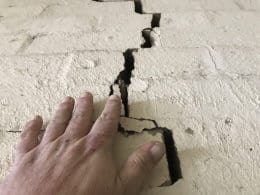 inspecting a cracked wall during a pre purchase inspection
