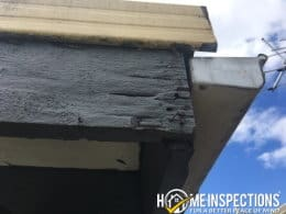 Damaged flashings and gutters on the roof of a house discovered during a building inspection